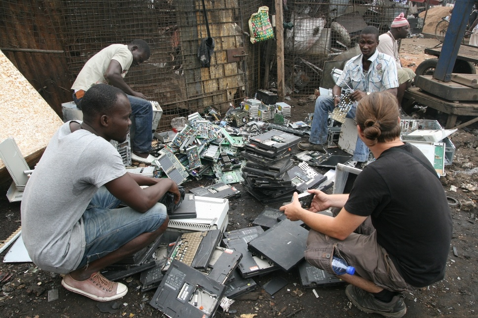Acquiring hard drives on the e-waste dump. Photo: Kairus.org