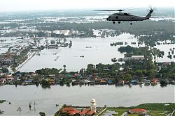 Helicopter surveying flood devastated suburban Bangkok